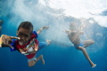 Kid s of Alor / Super friendly village came to greet the dive boat. Took this shot free diving with the local kids in Alor.