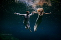 Cenote Trash the dress. Flying bride and groom in mexican cenote.