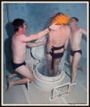 Royal Australian Navy  RAN  Submarine Escape Training. Trainees carry out escape drill from simulated submarine hatch in specialised freshwater 20metere deep training tank while two instructore watch on to assist. Nikonos V Fuji 800ASA SuperG print