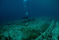 Diver/photographer explores wreckage in Little Tub Harbour  Tobermory  Ontario