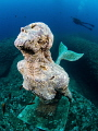 Mermaid statue dedicated to the memory of a female freediver in Sicily.
