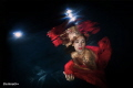 Underwater models in Italy - woman in red