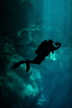 Light in front of this diver as he comes out of the shadow of the over hang created a silhouette shot.