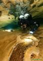 Goul de la Tannerie, France, Cave, Diver close up and minerals