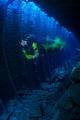 Speeding diver inside the wreck - long exposure