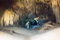 exploring cave stalagmites