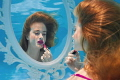 Getting Ready. Part of a collaborative underwater series based on getting ready for a night out. The model is sitting at a dressing table mirror putting on lipstick - underwater!