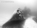 The USS Kittiwake has a ghostly feeling in black and white.  I love this wreck in Grand Cayman and continue to dive it every time I am there.