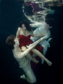 Ship wrecked in Red.  pool with Ballet Dancers