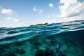 Sipadan island and a diver.