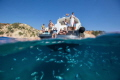 We had an amazing family day on a boat around Ibiza in the clearest water I have seen. There were so many fish swimming around the boat and I think this one captures the action above and below.