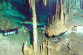 divers lighting the beauty of the Dreamgate cave  Riviera Maya Mexico