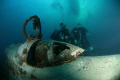 Group of divers posing with Betty Bomber-Truk Laggon
