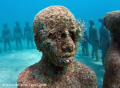Sculpture of Grenadian boy, by Jason deCaires Taylor. After 12 months underwater.