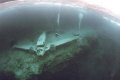 Airplane wreck under the ice at Morrison's Quarry, Quebec, Canada. Ambient light, Nikonos V, Sea& Sea 12mm lens, Fuji 400 ASA film on manual exposure. Colour corrected.