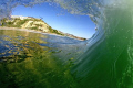 Inside out/barrel tube surfing...Salt Creek, CA, that's the Ritz Carlton (Dana Point) on the bluff.