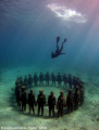 Divemaster Gary, free dives down to the vicissitudes statue installation.  Sculptures by Jason deCaires Taylor