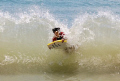 My son bodyboarding, gets hit by a wave returning from shore - it made a thunderous noise.