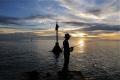 Sunset fishermen at Layang Layang