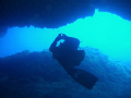 Diver getting into a canion in Ustica, Sicily, Italy
