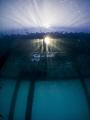 sunburst under the jetty in the morning. Olympus SP-350, Inon fisheye lens.
