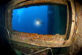 Shot of a diver on the wreck of the Zenobia. Taken with a Nikon D100 & 10.5mm lens.