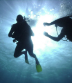 A helping hand. Local Scuba Instructor assists first time diver near Ochos Rios, Jamaica.