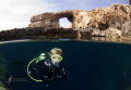 Diver in the Blue Hole, Maltese Islands (on Gozo), with the Azure Window in the Background. One of the last pictures of the Trip... taken first week of June 2011, Nikon D200, Tokina 10-17, Inon Z240s