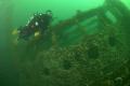 Diver fins past the bridge of the Hispania Wreck