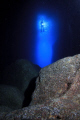 Diver in the entrance of a cave