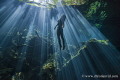 Morning sun rays at Cenote Cristalino, Quintana Roo, México. The model was freediving and amazed by the awe of the beauty in this spectacular natural wonders.