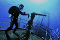 Putting out fires off the bow of the Kitiwake wreck in Grand Cayman..