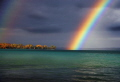 This is a Rainbow over Torch Lake, in Michigan. The fall colors make the pic even better.