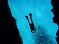 This shot of a diver above me was taken in the clearest  coldest water I have ever dived in  at Silfra  Iceland. It is called  the dive between the continents  and is inland crack between American and European tectonic plates filled with glacial wate