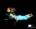 Shot in my pool, black background and 3 strobes.  Daylight.